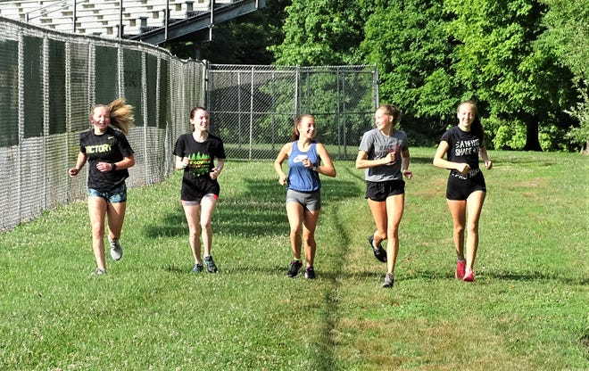 Lancaster seniors, from left to right, Grace Parrett, Cassidi Bates, Kayla Day, Sarah Craft and Meagan Ward, take a short run after team workouts on Tuesday. The Lady Gales are gearing up for their cross country season.