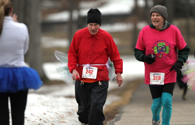 Harrison Hensley (242) of Pinckney, 87, runs nearly 100 races a year, but has run only nine so far in 2020 because of cancellations related to COVID-19.