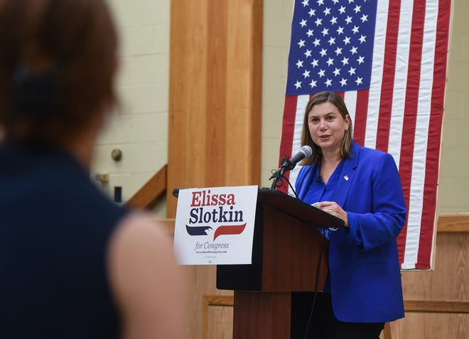 U.S. Rep Elissa Slotkin, D-MI 8th District speaks to a reporter while campaigning to a small room of social-distanced reporters and UAW members, Friday, July 10, 2020, at the UAW Local 652 headquarters in Lansing.