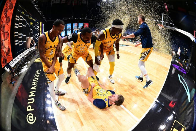 The Golden Eagles surround Travis Diener after he hit a three-pointer to win the The Basketball Tournament on Tuesday.