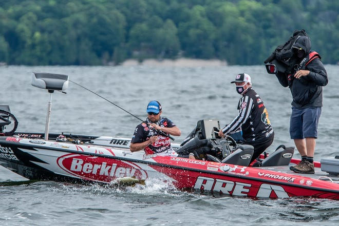 Pro angler Justin Lucas prepares to land a smallmouth bass while fishing in the Major League Fishing 2020 Bass Pro Tour Covercraft Stage Five Presented by Abu Garcia in Sturgeon Bay, Wis.
