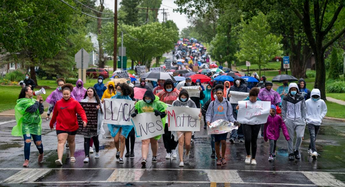Students from the Monona Grove School District lead a protest walk for racial justice and equity Wednesday along Nichols Road. Andy Manis, State Journal