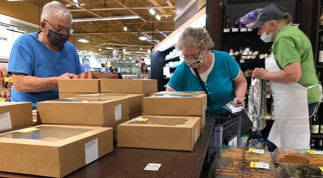 Some customers wear masks while shopping July 13 at a Pick 'n Save store in Fond du Lac. Employees and customers are required to wear masks at the store.