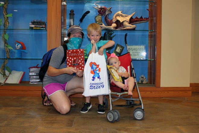 Summer Reading Program participants visit the library to pick up their prizes.