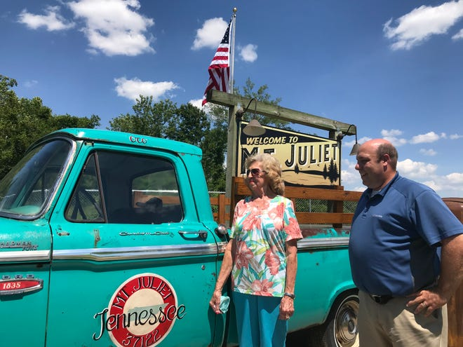 Betty Hamblen, left, and Yancy Belcher, right, look at the 1964 Ford truck that is now part of the new Mt. Juliet welcome display. The former display vehicle was destroyed in the March 3 tornado.