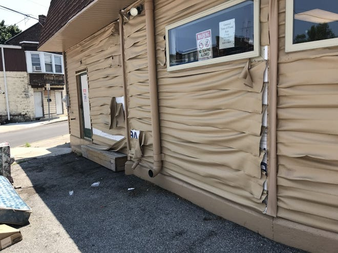 A fire started by hot firework remnants melted the siding at Mr. Sandy's Homeless Veterans Center in York on July 4, 2020.