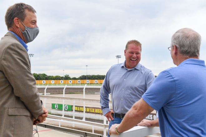 Tod Quiring, center, the new owner of Huset's Speedway, talks with Brandon mayor Paul Lundberg and the city administrator Bryan Read on Wednesday, July 15, at the race track in Brandon.