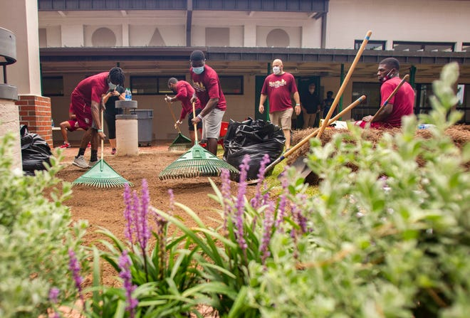 Florida State University football players work on several different beautification projects at John G. Riley Elementary School on Wednesday, July 15, 2020.