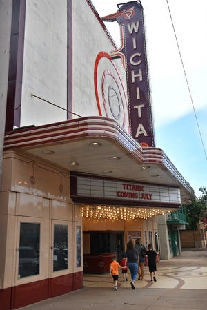 """A group heads into the Wichita Theatre for the modern classic children's movie """"Monsters Inc."""" Wednesday morning."""