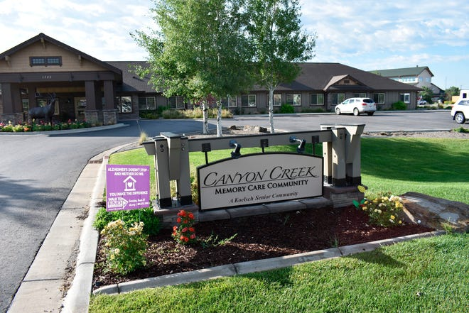 The Canyon Creek Memory Care Community is seen in Billings, Mont. on Friday, July 10, 2020. The facility that cares for people with dementia and other cognitive issues has seen at least seven deaths since a coronavirus outbreak sickened almost all its residents and many staff members.