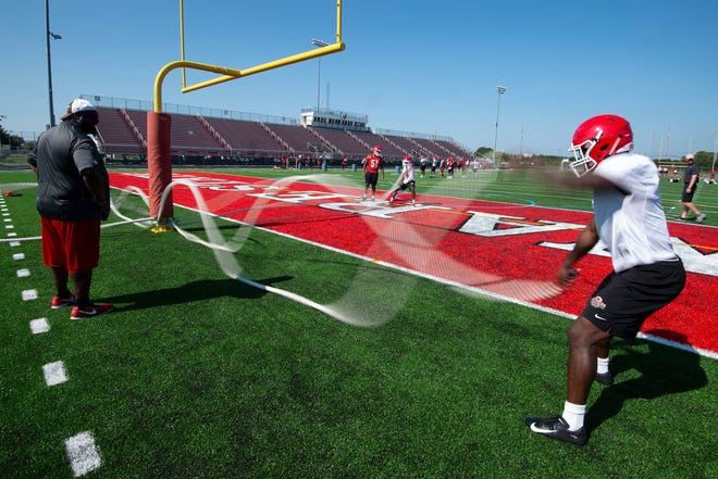 File photo of Delaware State University's football team practicing at Alumni Stadium in Dover.
