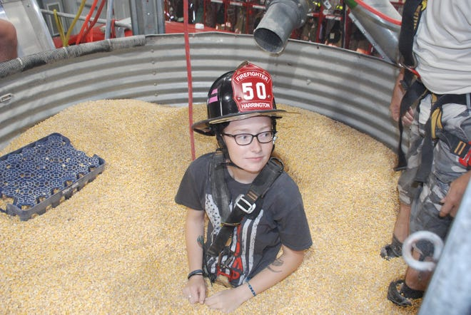 Volunteer firefighter Makayla Parson helped demonstrate how the grain bin rescue tube works at the Harrington Fire Department in 2019.