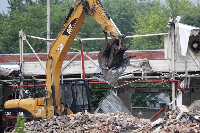 The MRD Group of Milwaukee demolishes the former Banta Corp. printing plant on Ahnaip Street in Menasha. Bricks from the building will be crushed for reuse.