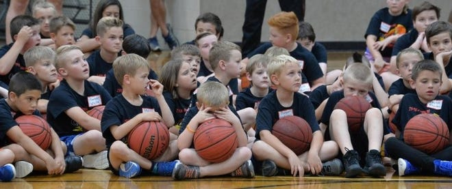 Campers listen during last year's Crossfire Ministries basketball camp at Hendersonville First Baptist Church.