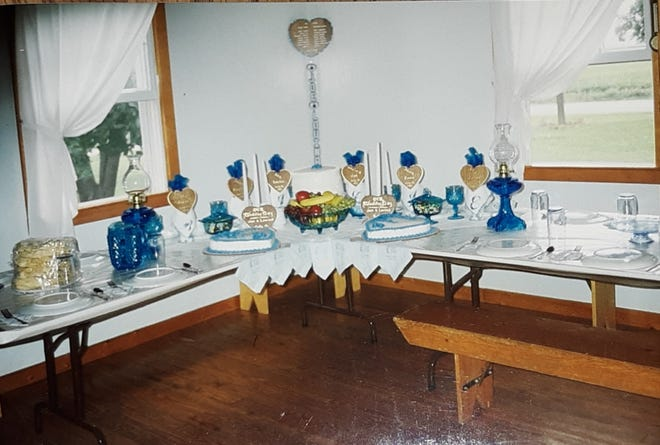 Tables decorated for Lovina and Joe Eicher's wedding in 1993.