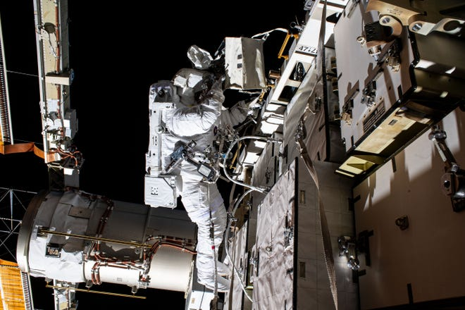 NASA astronaut Bob Behnken during a spacewalk to swap batteries and upgrade power systems on the International Space Station.