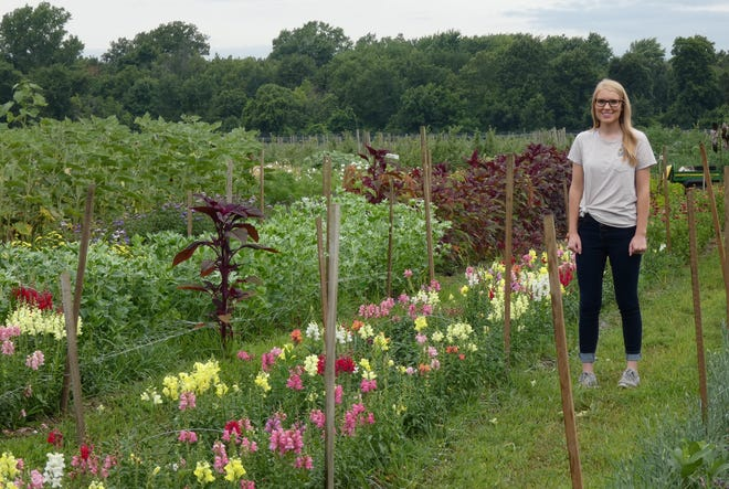 Hannah Stuckey of the Ohio Flower Girls stands in her business' u-pick flower garden.