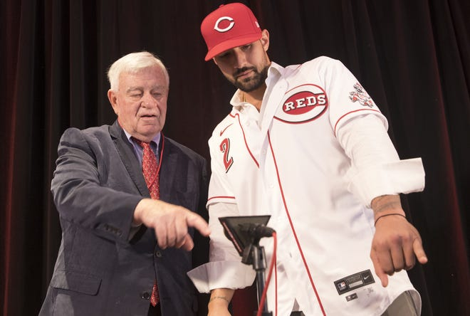 Reds CEO Bob Castellini speaks with Nick Castellanos after a press conference announcing Castellanos as a Reds player Tuesday, Jan. 28, 2020 at Reds Hall of Fame and Museum in downtown Cincinnati.