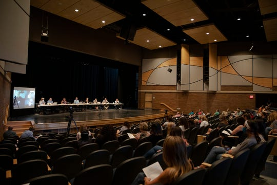 Attendees listen to submissions during the Clear Creek-Amana school board meeting at Clear Creek-Amana High School on Wednesday, July 15, 2020. Community members asked for an anti-racist curriculum and for a push for equity within their schools.