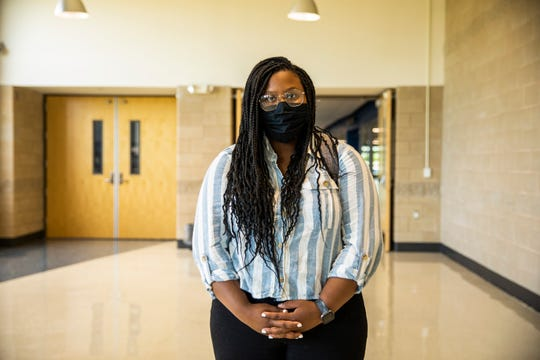 Iowa City West High Senior Dasia Taylor, 16, poses for a portrait before the Clear Creek-Amana school board meeting at Clear Creek-Amana High School on Wednesday, July 15, 2020. Taylor previously attended Clear Creek-Amana, but transferred after racial slurs were said to her by her classmates.