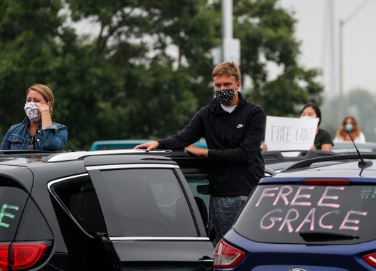 Protesters listen to speakers in their vehicles during the #FreeGrace car caravan and rally outside of Oakland County Circuit Court and Prosecutor's Office in Pontiac on  July 16, 2020.