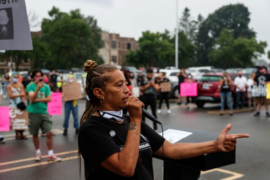 Machelle Pearson, juvenile justice advocate and justice advisor with Michigan Liberation speaks during the #FreeGrace car caravan and rally outside of Oakland County Circuit Court and Prosecutor's Office in Pontiac on July 16, 2020.