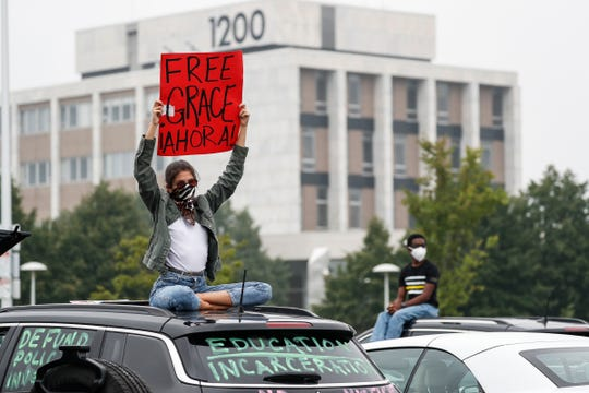 Protesters listen to speakers with social distance during the #FreeGrace car caravan and rally outside of Oakland County Circuit Court and Prosecutor's Office in Pontiac on July 16, 2020.