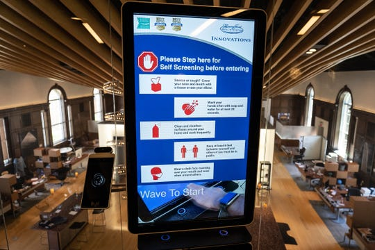 A contactless infrared screening kiosk is seen in the Henry Ford Health System Innovations building at Henry Ford Hospital in Detroit on June 29, 2020.