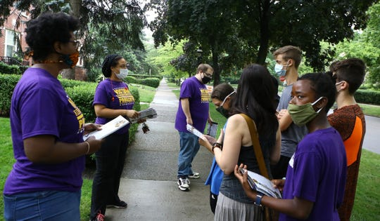 Victoria Burton-Harris candidate for Wayne County prosecutor and her team walk down Seminole Street in Detroit canvassing on July 16, 2020.