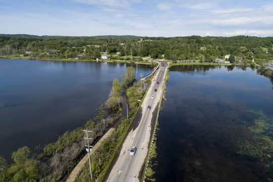 Traffic proceeds in alternating turns down the center of M-22 in Elberta due to encroaching water from the Betsie River, as seen in this June 24, 2020 aerial photo.