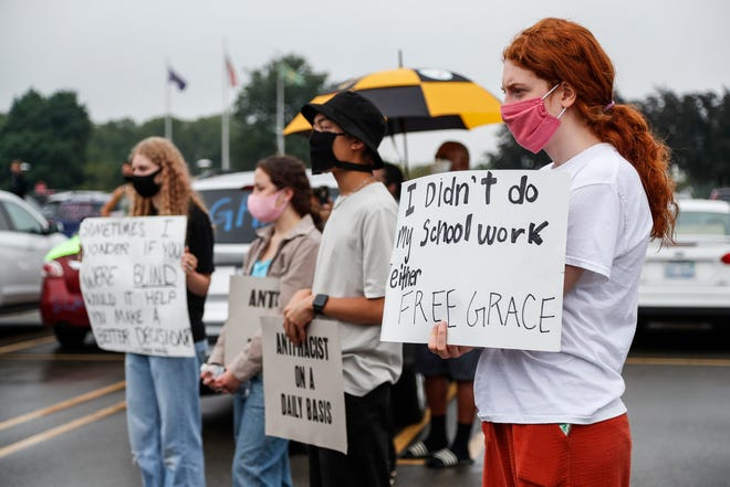 Protesters listen to speakers during the #FreeGrace car caravan and rally outside of Oakland County Circuit Court and Prosecutor's Office in Pontiac on July 16, 2020.