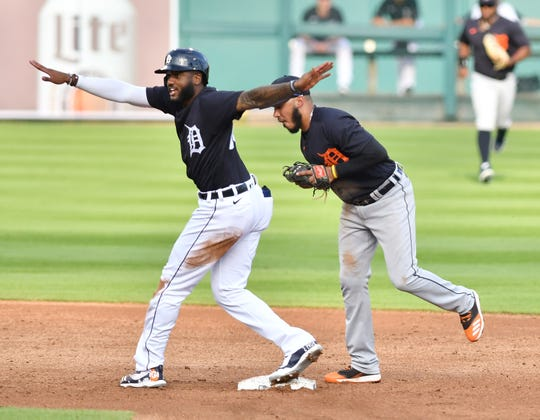 Tigers' Niko Goodrum, left, reacts after trying to beat the throw to Harold Castro at second base during Wednesday's intrasquad game at Comerica Park.