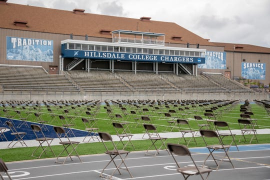 """Hundreds of chairs line the field in preparation for a graduation commencement ceremony at Frank """"Muddy"""" Waters Stadium, at Hillsdale College, in Hillsdale, July 16, 2020."""