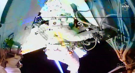 In this image taken from NASA video, NASA astronaut Chris Cassidy works outside the International Space Station on Thursday, July 16, 2020. Cassidy and Bob Behnken ventured out on their third spacewalk over the past few weeks to remove six more old batteries in the space station's power grid.