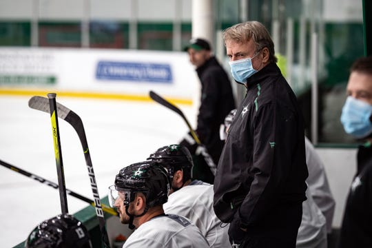 Dallas Stars coach Rick Bowness coached from behind the bench the first couple days of training camp.