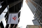 In this Oct. 14, 2019, file photo photo a Bank of America flag waves in front of the Bank of America Financial Center building, in Boston. Because it is so consumer-focused, BofA is feeling the effects of the coronavirus pandemic more acutely than other major banks.