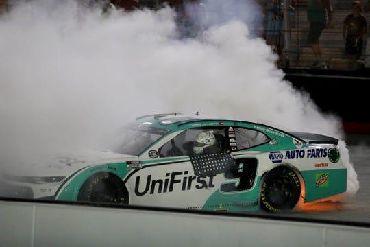 Chase Elliott celebrates after winning a NASCAR All-Star auto race at Bristol Motor Speedway.