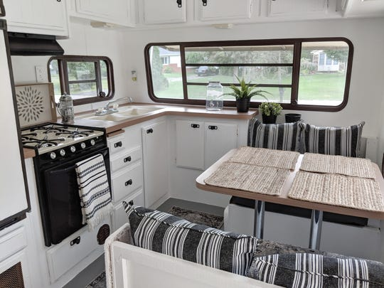 The kitchen after Lemp worked her magic. When it comes to decorating an RV, Lemp suggests using lightweight items but keep it to a minimum, choosing space-saving items.