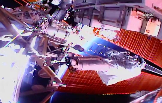 In this image taken from NASA video, NASA astronaut Chris Cassidy works outside the International Space Station on Thursday, July 16, 2020.