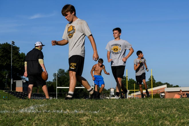 Boonville High School football players run footwork drills during practice last Tuesday.