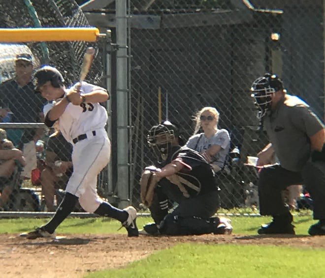 Chargers outfielder Andrew Paradise rips a two-run double July 15 against Helena at Don Olson Field. He suffered a dislocated and broken wrist in Sunday's doubleheader against Bozeman and is out for the season.