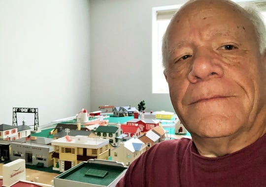 """Terry McCullough of North Liberty, part of the retired vet coffee group, says he recently dusted off the 30 or so Plasticville miniature buildings he collected when he was 12 and has been assembling this town with model train equipment as his pandemic project. """"It was stored for 60 years,"""" he said, """"but COVID has given me the time to work on it."""" He served on a Navy aircraft carrier during the Vietnam War."""