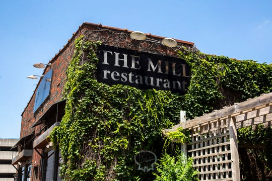 Vines grow on the side of The Mill restaurant, Wednesday, July 8, 2020, in Iowa City, Iowa.