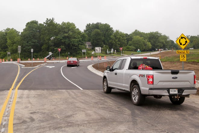 Cars travel around the roundabout located at the intersections of Indiana 26 and Newman Road, Thursday, July 16, 2020 in West Lafayette. The roundabout, part of a larger $12.5 million project along Newman Road, opened to traffic Wednesday.