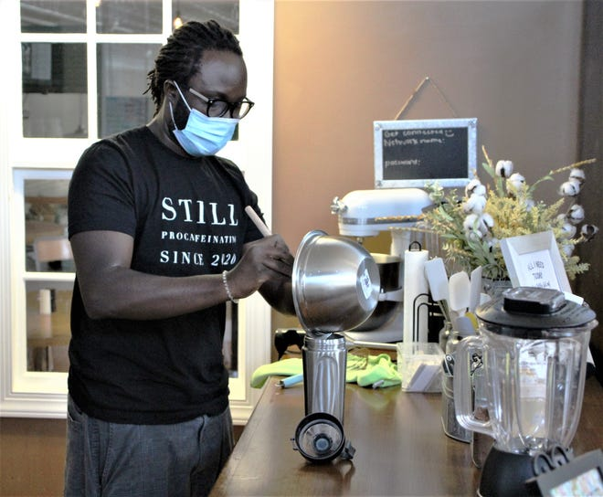 KD Ahossin prepares an iced coffee at Still Procaffeinating LLC, a new coffee shop located at Charleston Place in downtown Marion. Ahossin's wife Lyndsi started making iced coffees out of the family home after the coronavirus pandemic started and the business has grown since then. Still Procaffeinating LLC is co-located with the Candy Shack Cafe, a popular eatery on the second floor of Charleston Place.