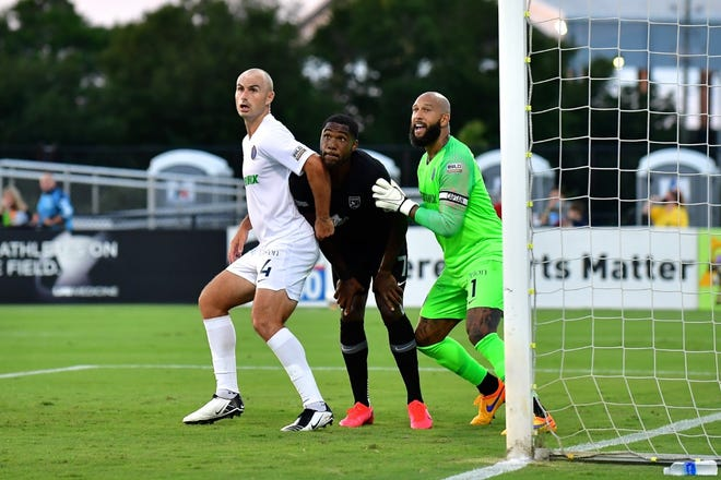 Memphis 901 FC defender Liam Doyle, left, and goalkeeper Tim Howard, right, during a match against Birmingham Legion. Memphis lost 3-0 in Birmingham during the first game back after the USL season was suspended due to COVID-19.