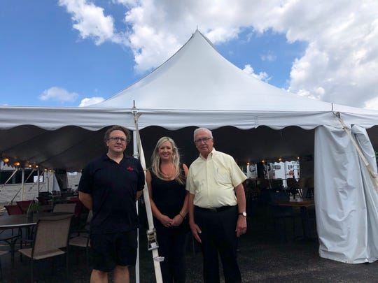 Michael (left), Catherine and Tom Warren of Alioto's in Wauwatosa put up a tent in the back parking lot of their restaurant so more customers can feel safe when dining-in at the restaurant.