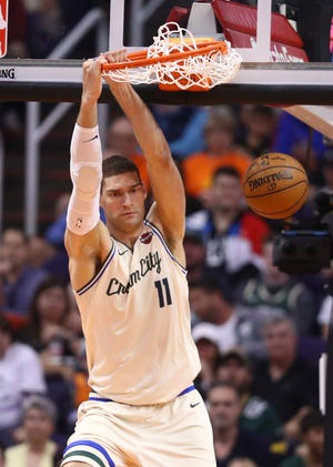 Bucks center Brook Lopez dunks against the Suns at Talking Stick Resort Arena on March 8.