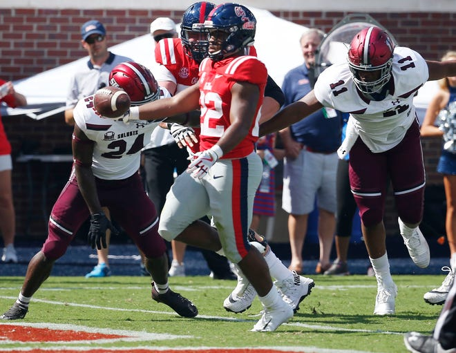 Southern Illinois defenders can't keep Mississippi running back Scottie Phillips out of the end zone in a nonconference game. Southern Illinois was supposed to make $500,000 for a non-conference game at Wisconsin in September.