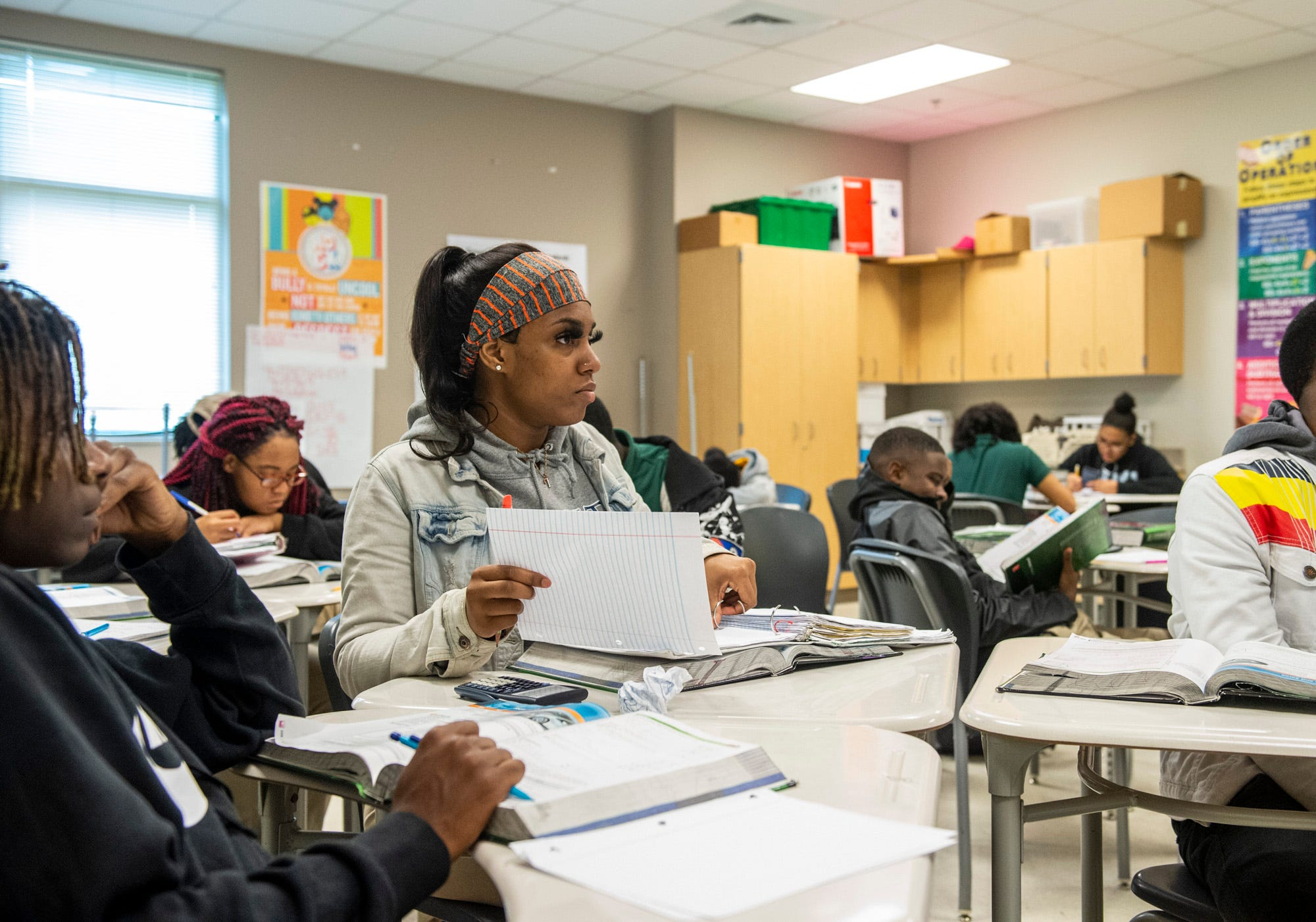 Helen Brown takes notes in math class at Carver High School in Montgomery, Ala., on Tuesday, Feb. 25, 2020.